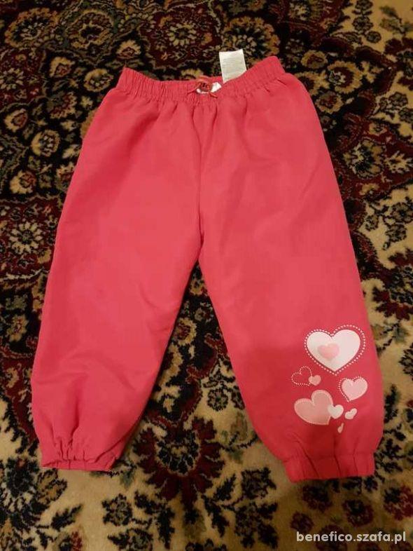 rózowe spodnie na polarku rozm 86