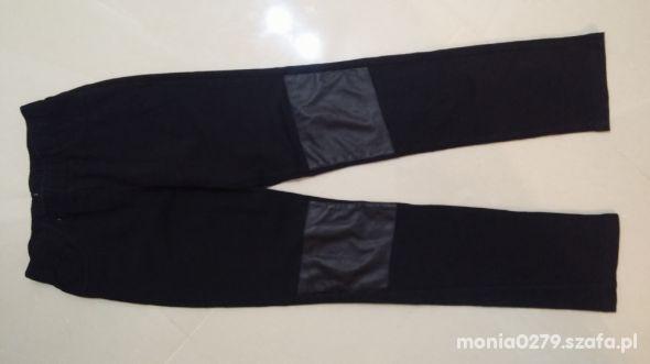 Bawełniane spodnie 146