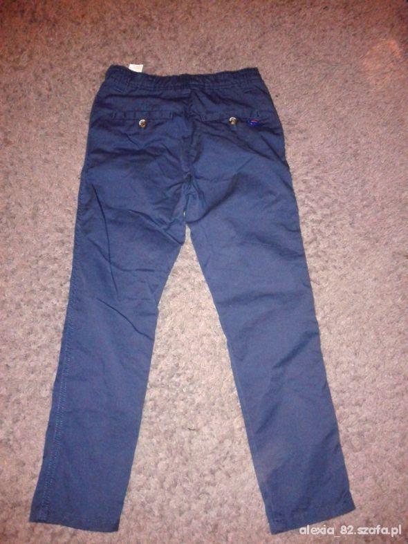 Spodnie chinosy RESERVED Kids 128 jak nowe w Spodnie i