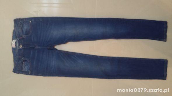 Spodnie Reserved jak nowe 164